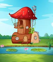 Paddestoelen houten huis in de natuur vector