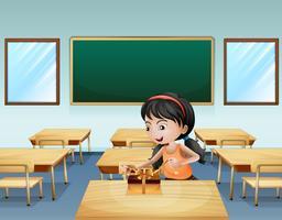 Een klein meisje dat een cadeau verpakt vector