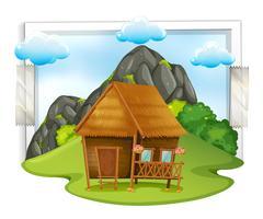 Houten hut in het veld