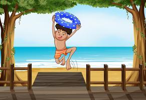 Een jongen op het strand vector