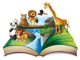 Boek met wilde dieren bij waterval