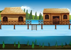 Scène met twee huizen in de rivier