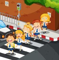 Studenten oversteken de weg vector