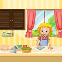 Moeder die en voedsel in Keuken schoonmaakt voorbereidt