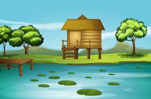 Een hut aan de rivieroever vector