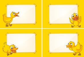 Vier grenssjablonen met gele eendjes vector