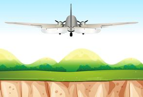 Vliegtuig vliegt over de heuvels