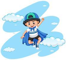 Gelukkige jongen met blauwe kaap vector