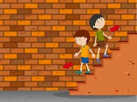 Jongens lopen de trappen op en af