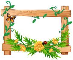 Houten frame met bloemen en insecten
