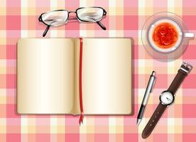 Een topview van een tafel met verschillende objecten vector