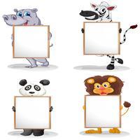 Vier verschillende dieren met lege whiteboards vector