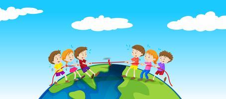Kinderen spelen touwtrekken op aarde