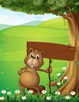 Een bever die onder de boom met een leeg bord staat