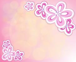 Een roze briefpapier met bloemen