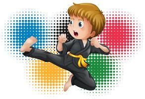 Jongen in zwart uniform karate vector
