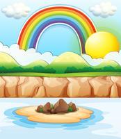 Scène met regenboog op zee