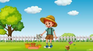 Een jongen met waterplanten in de tuin