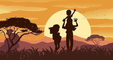 Silhouetscène met familie in het park