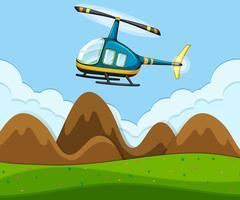 Een helikopter vliegt boven de grond