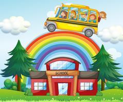 Kinderen op schoolbus die over de regenboog berijdt