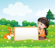 Een meisje dat een lege lege raad met een konijn houdt