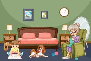 Grootmoeder met kind en hond in de kamer
