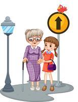 Grootmoeder en kind steken de straat over
