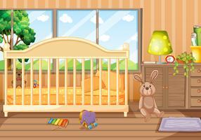 Slaapkamer scène met speelgoed en babybedje
