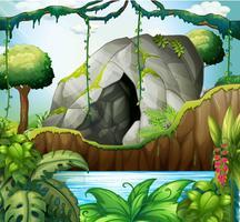 Scène met grot in het diepe bos vector