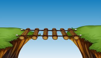 Houten brug tussen kliffen