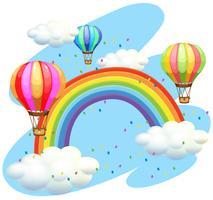 Ballonnen vliegen over de regenboog