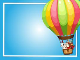 Grensmalplaatje met Kerstman die in ballon vliegen
