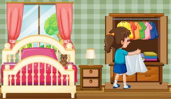 Een meisje in de slaapkamer met kledingkast