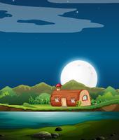 Betoverde houten huis in de nacht