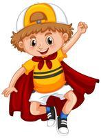 Kleine jongen met rode cape vector