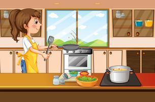 Vrouw het koken in keuken