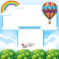 Grensmalplaatje met ballon en vliegtuig in hemel