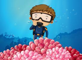 Scuba-duiker die onder de oceaan duikt