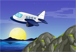 Vliegtuig die in hemel bij nacht vliegen vector