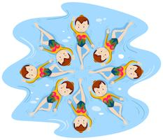 Meisjes doen gesynchroniseerd zwemmen in team