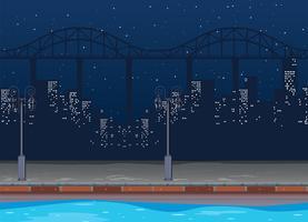 Naadloze achtergrond met gebouwen in de stad 's nachts