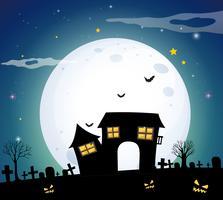 Spookhuis in het veld op volle maan nacht