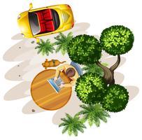 Een bovenaanzicht van een tafel met een man, een boom en een voertuig