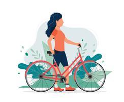 Gelukkige vrouw met een fiets in het park. Vectorillustratie in vlakke stijl, concept illustratie voor een gezonde levensstijl, sport, oefenen. vector
