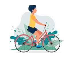 Gelukkige mens met een fiets in het park. Vectorillustratie in vlakke stijl, concept illustratie voor een gezonde levensstijl, sport, oefenen.