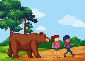 Twee wandelaars en een grizzlybeer in het veld vector