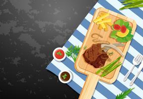 Achtergrondmalplaatje met lambchop en gebraden gerechten