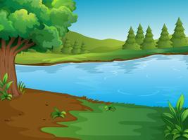Rivierscène met bomen en heuvels