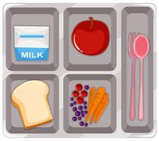 Kantinevoedsel met fruit en melk